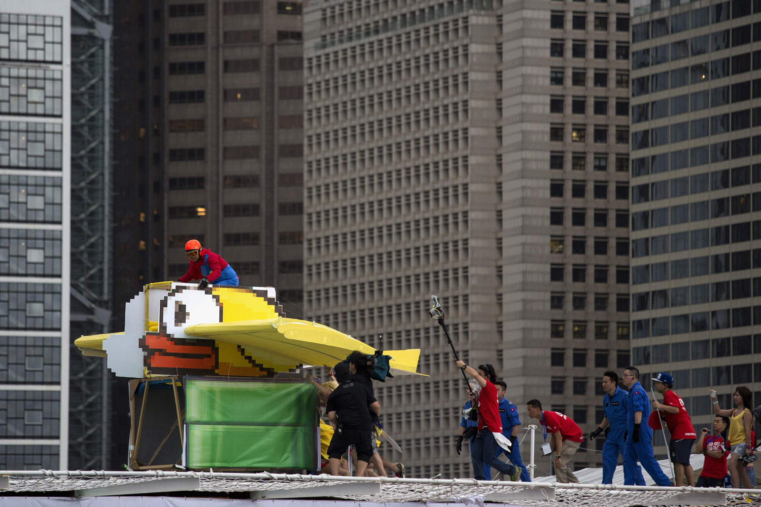 A participant operates the  Flappy Bird , a self-made flying machine, during the Red Bull Flugtag event at Hong Kong's financial Central district May 11, 2014.