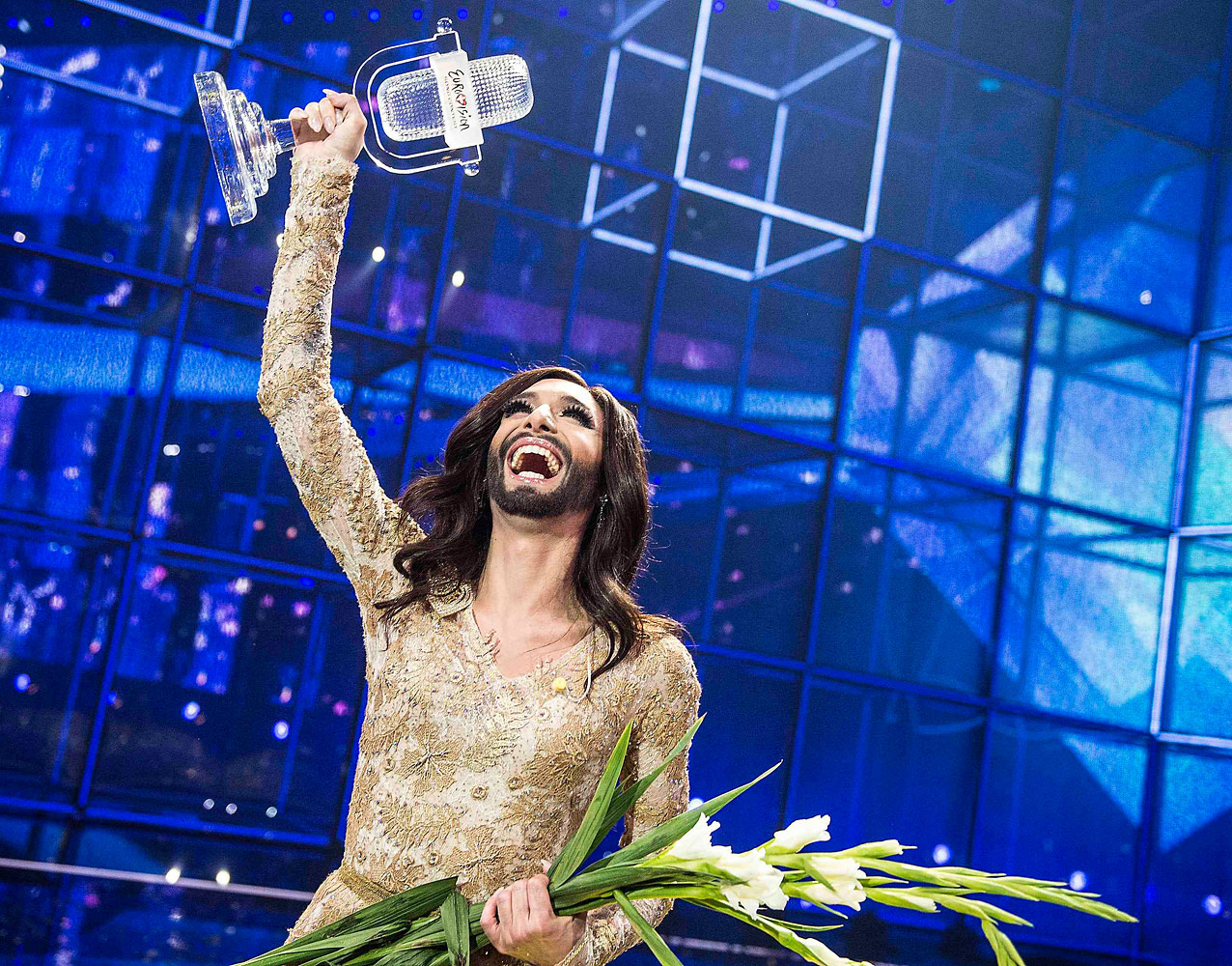 Conchita Wurst representing Austria celebrates with the trophy after winning the 59th annual Eurovision Song Contest (ESC) at the BW Hallerne in Copenhagen, in this May 10, 2014 picture provided by Scanpix Denmark.
