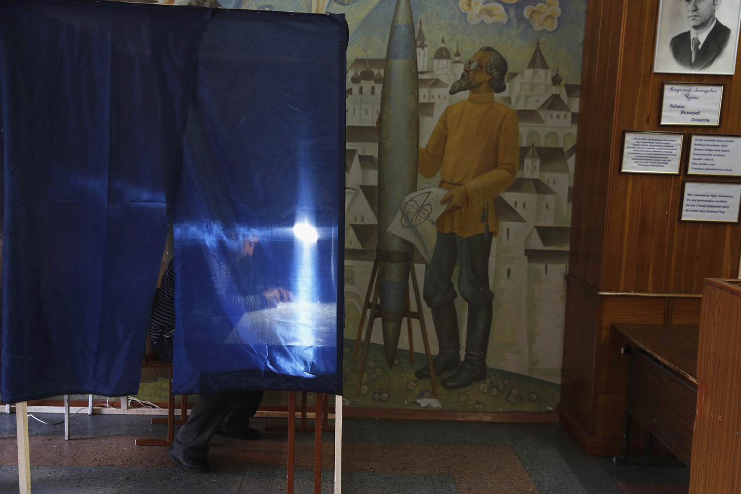 May 11, 2014. A man completes a form for the referendum at a polling station in the eastern Ukrainian city of Donetsk.