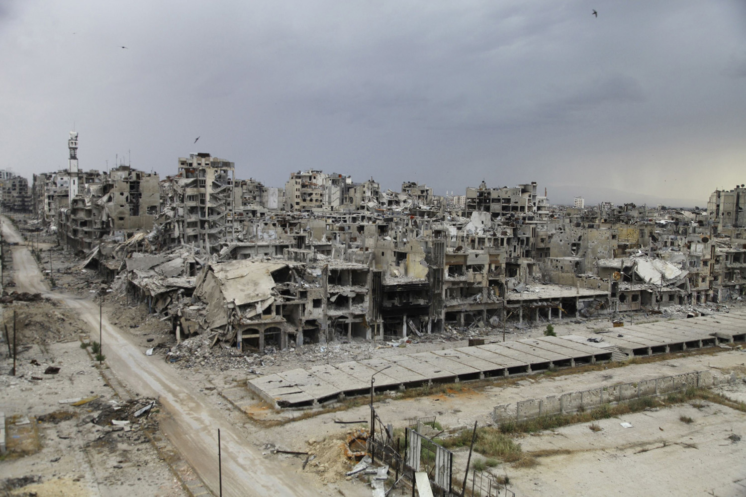 May 10, 2014. Destroyed buildings are pictured, after the cessation of fighting between rebels and forces loyal to Syria's President Bashar al-Assad, in Homs city.
