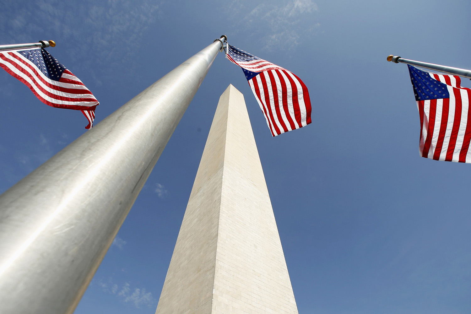 May 12, 2014. Flags flutter during the re-opening ceremony for the Washington Monument in Washington.