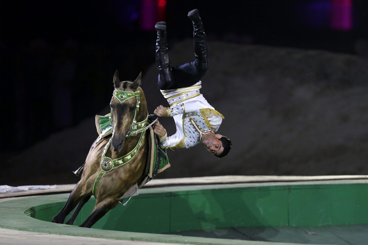 A Turkmenistan man performs on a horse during the opening ceremony of 2014 International Akhal-Teke Horses Association Special Conference and China Horse Culture Festival at Forbidden City, in Beijing, China, May 12, 2014.