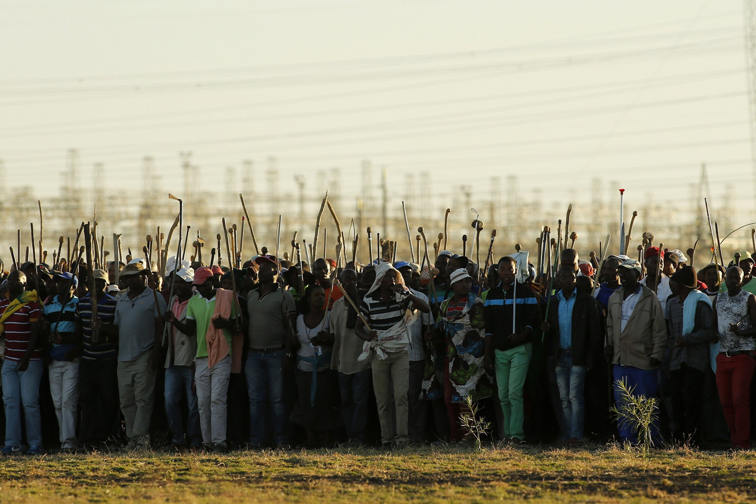 May 13, 2014. Miners on strike chant slogans as they march in Nkaneng township outside the Lonmin mine in Rustenburg,  South Africa.