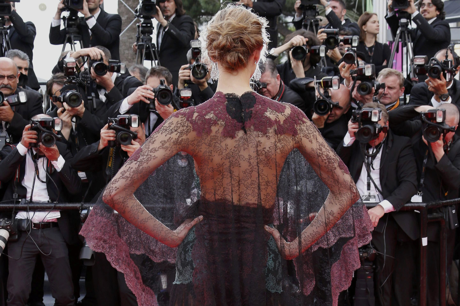 May 14, 2014. Model Karlie Kloss poses on the red carpet as she arrives for the opening ceremony and the screening of the film  Grace of Monaco  (Grace de Monaco) during the 67th Cannes Film Festival in Cannes.