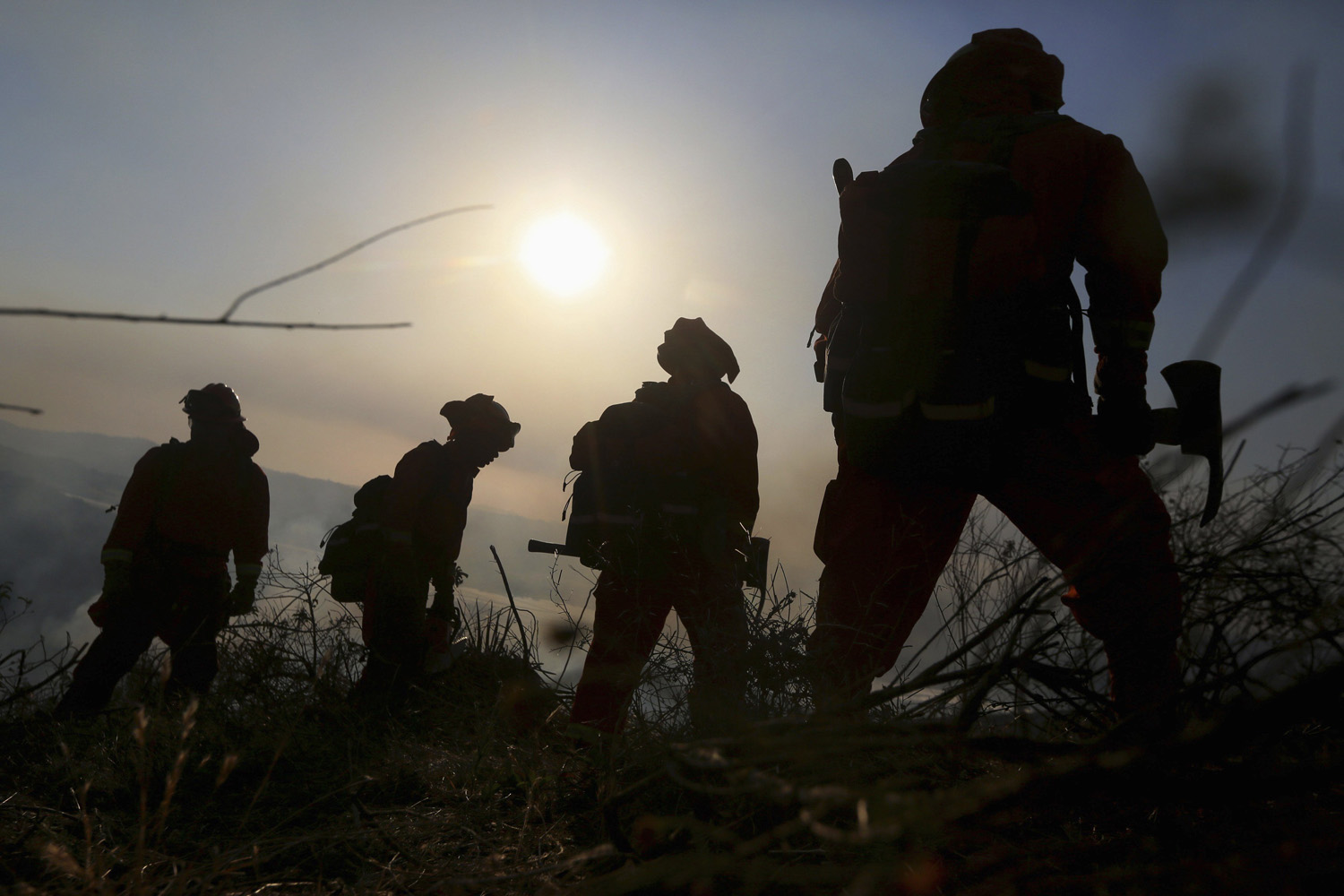 May 14, 2014. A prison crew battles a fire in an avocado grove outside Fallbrook, California.