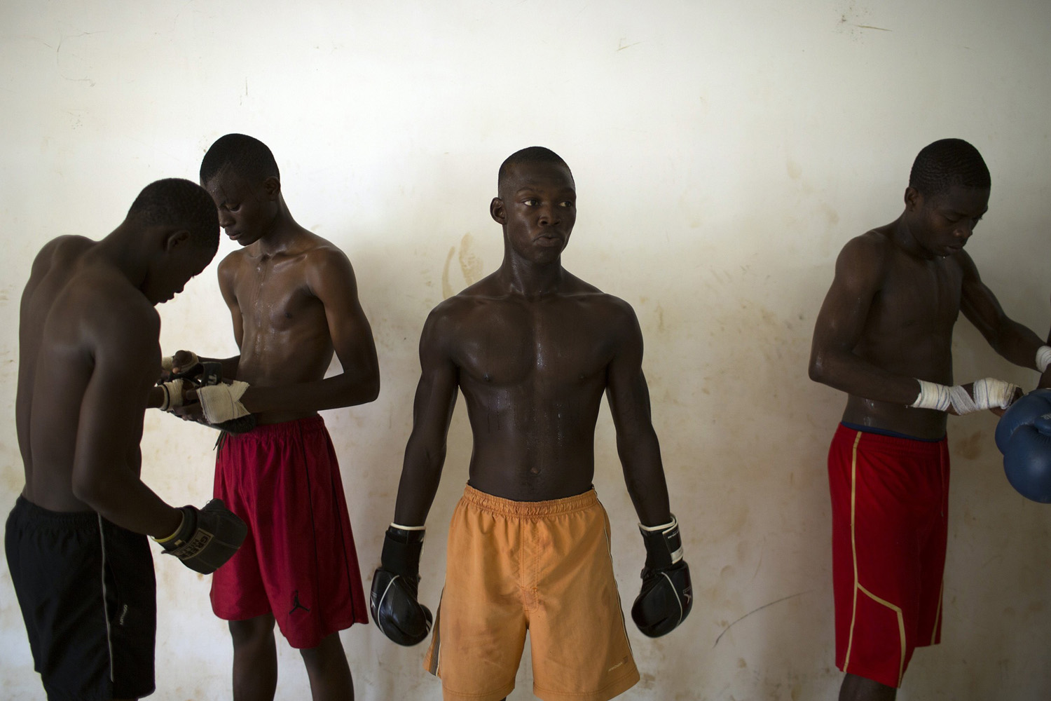 May 14, 2014. Men take part in Thai boxing training at the Barthelemy Boganda stadium in the capital of Bangui.