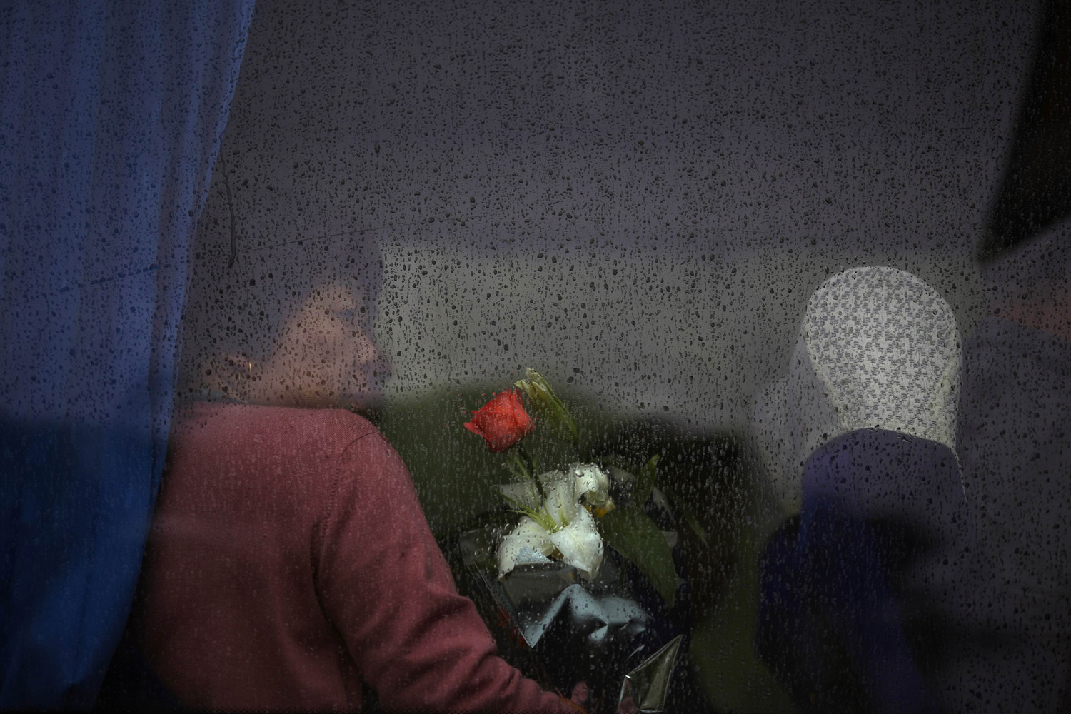 May 10, 2014. A mourner waits for the bus to depart for a sea burial ceremony in Shanghai.
