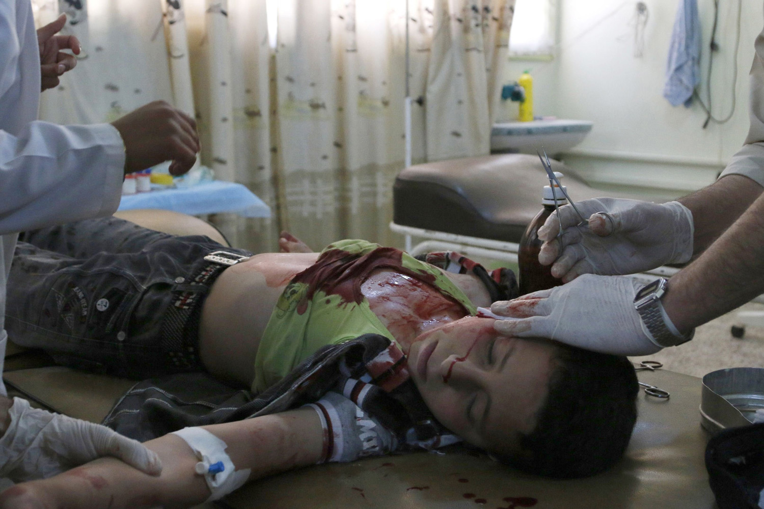 May 15,  2014.  A medic helps a boy, who was injured after what activists say was an air strike by forces loyal to Syrian President Bashar al-Assad, at a hospital in Maarat Al-Nouman, Idlib province.