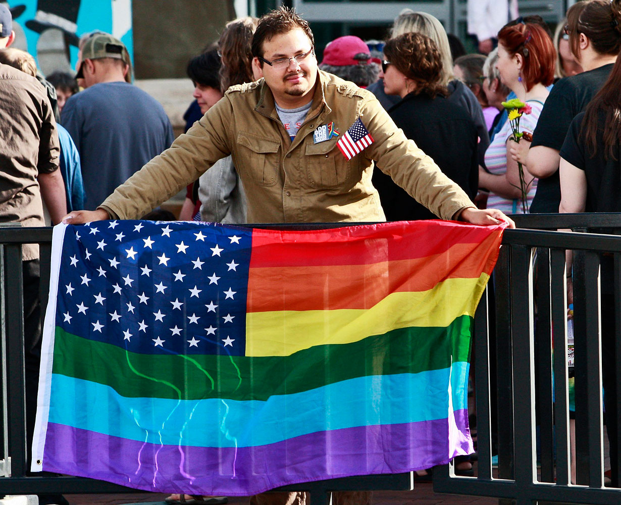 A gay marriage supporter holds his interpretation of the American flag at a rally for gay marriage at the Ada County Court House  in Boise, Idaho May 16, 2014.