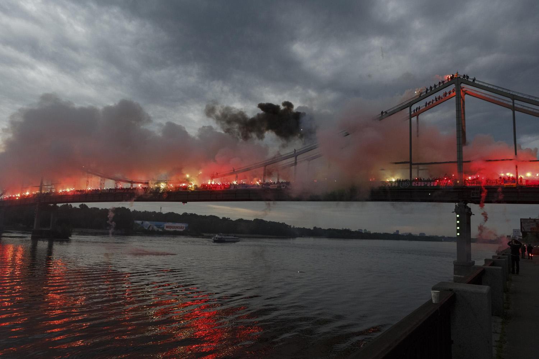 May 18, 2014. Ukrainian soccer fans light flares on a bridge across the Dnieper River in Kiev.