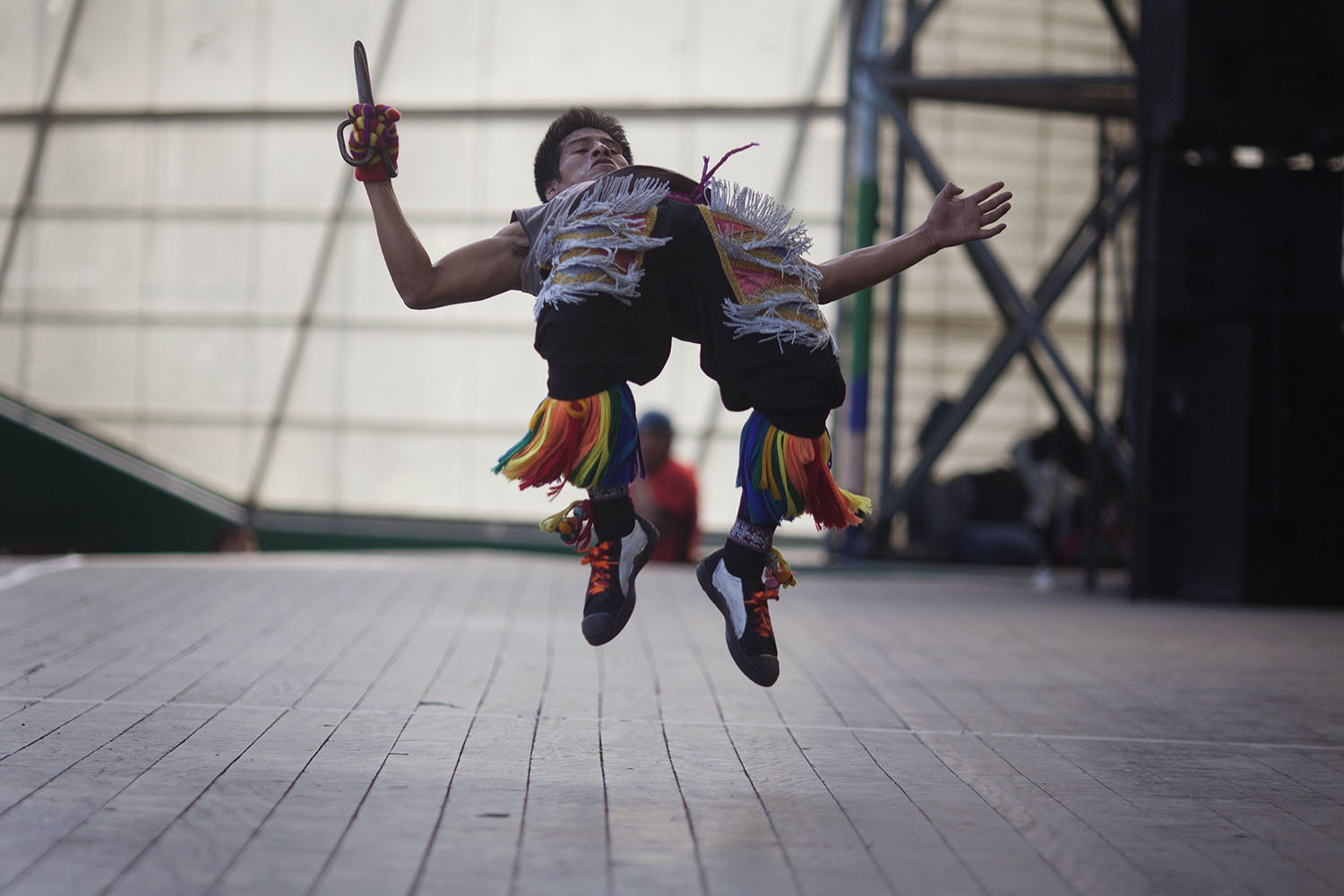 A  scissors  dancer performs in a national scissors dance competition at Lima's Exposition Park, on May 18, 2014.