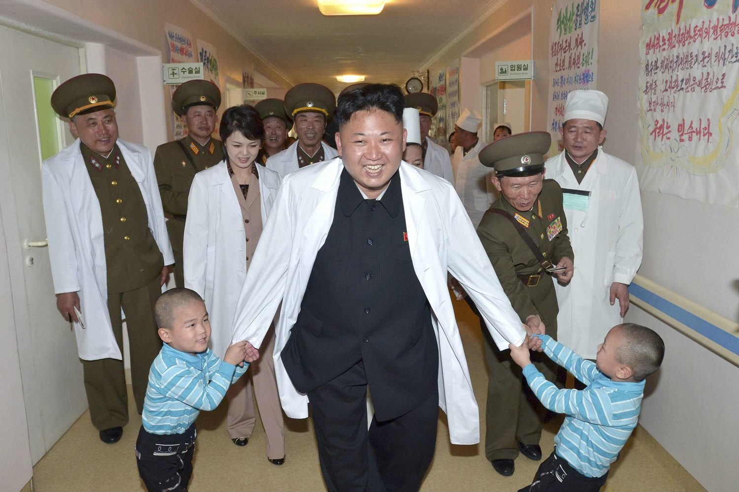 North Korean leader Kim Jong Un plays with children during a visit to the Taesongsan General Hospital in this undated photo released on May 19, 2014.