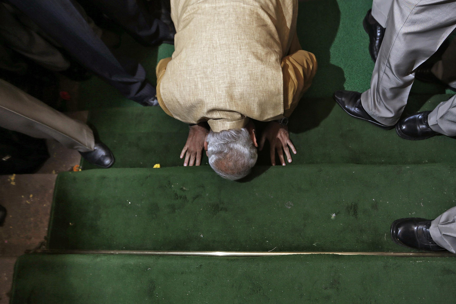 May 20, 2014. Hindu nationalist Narendra Modi, the prime ministerial candidate for India's Bharatiya Janata Party (BJP), bows down in respect at the steps of the parliament house upon his arrival to attend the BJP parliamentary party meeting in New Delhi.