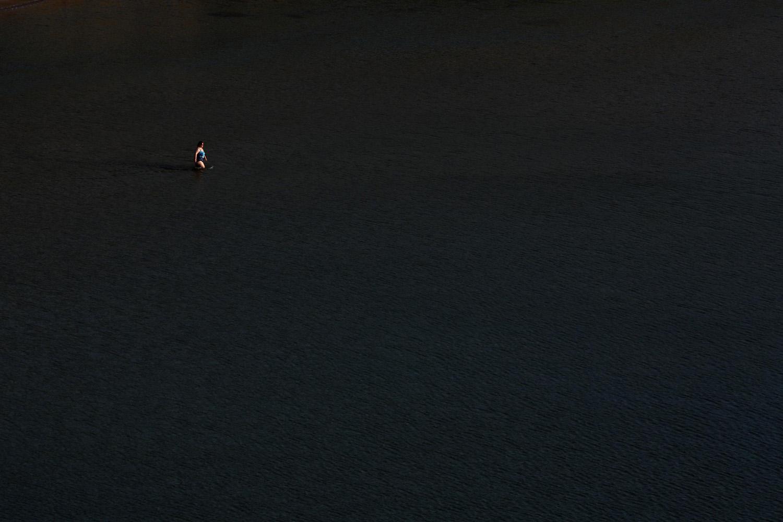 May 20, 2014. A woman wades into the sea at Ghajn Tuffieha (Apple's Eye) Bay on the northwest coast of Malta.