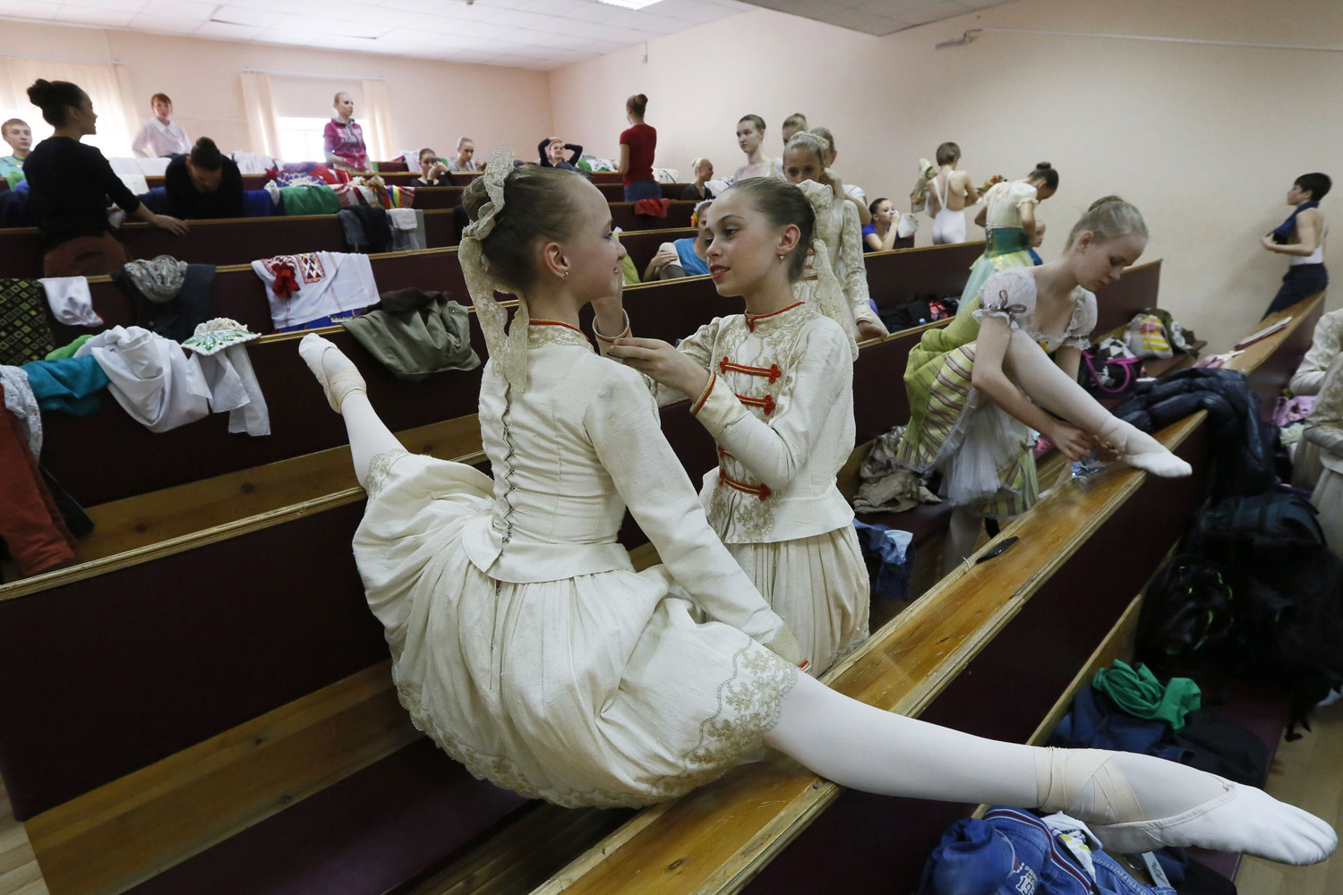 May 20, 2014. Students of the Krasnoyarsk choreographic college prepare backstage before a dress rehearsal of a performance by graduates of the college at the State Theatre of Opera and Ballet in Russia's Siberian city of Krasnoyarsk.