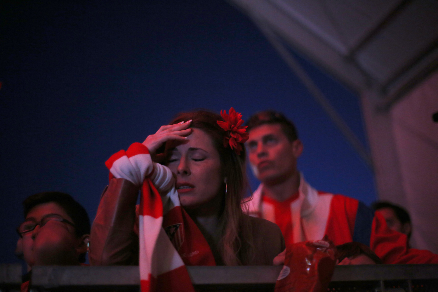 May 24, 2014. Atletico Madrid's fans react during Champions League final soccer match between Atletico Madrid and Real Madrid at a public screening in Lisbon.