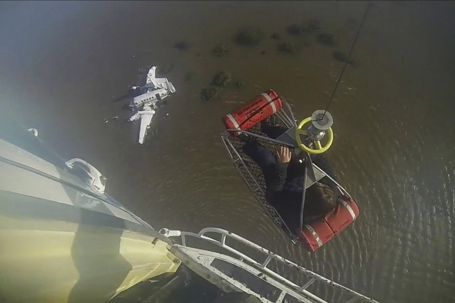 May 27, 2014. An injured person is lifted by a rescue helicopter after a small private plane which took off from San Fernando, Argentina, en route to Carmelo, Uruguay, with nine people on board, crashed into the Rio de La Plata.