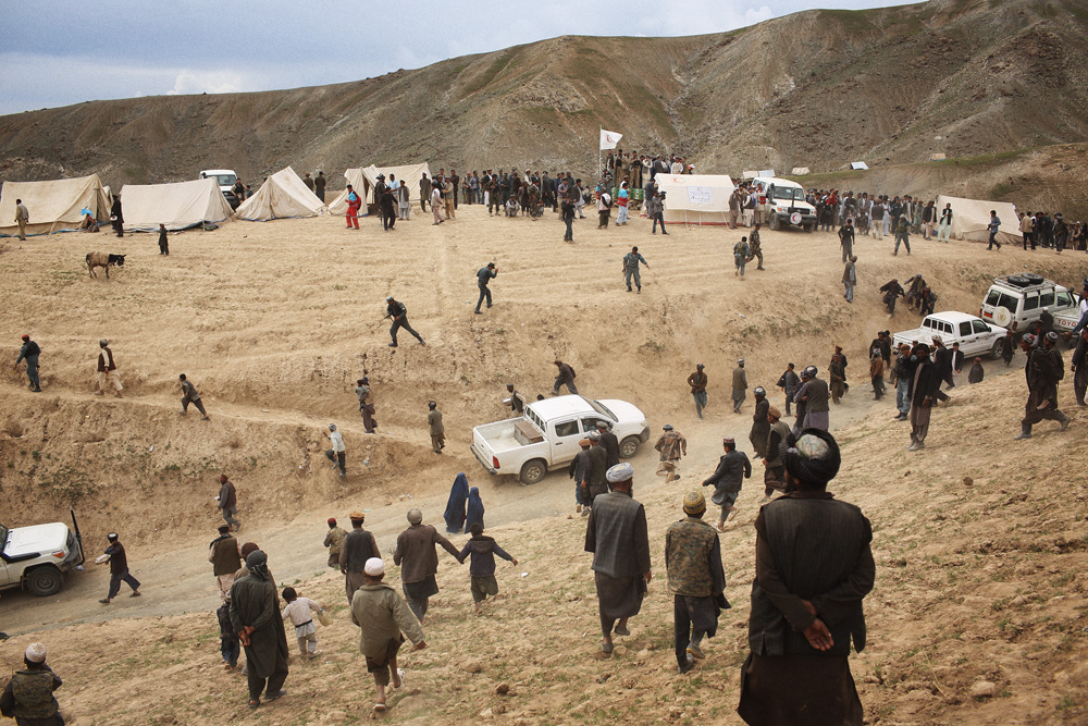 Baktash Siawash, a 28-year-old parliamentarian and former Afghan TV show host, was pursued by villagers after handing out 1000 Afghani bills (approx $US20).Siawash, who was angered by the unruly crowds, walked down this hill, and climbed up the opposite one, May 4, 2014.