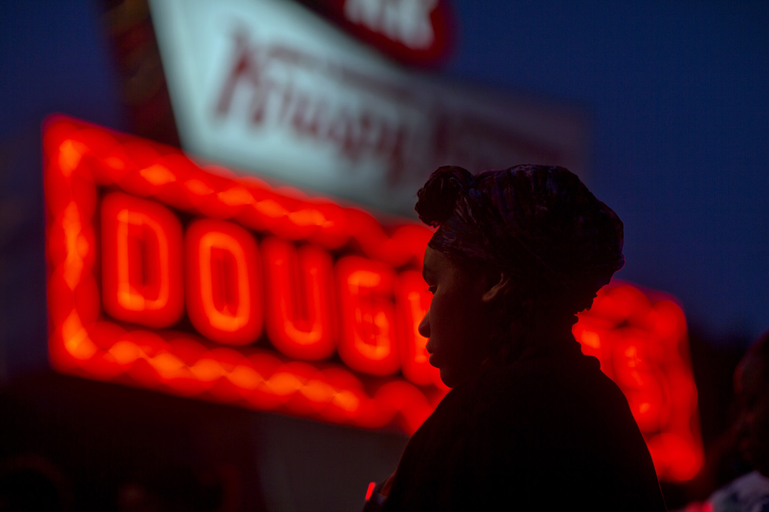 May 15, 2014. Burger King employee Keisha King, 23, stands during a protest outside a Krispy Kreme store in Atlanta.