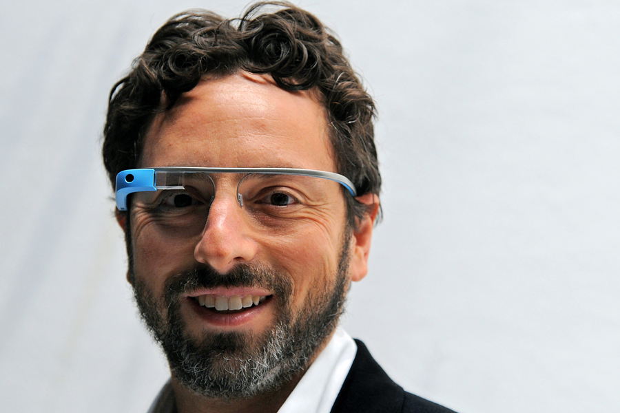 Sergey Brin, co-founder of Google Inc., stands for a photograph while wearing Project Glass internet glasses at the Diane Von Furstenberg fashion show in New York, N.Y., on Sunday, Sept. 9, 2012.
