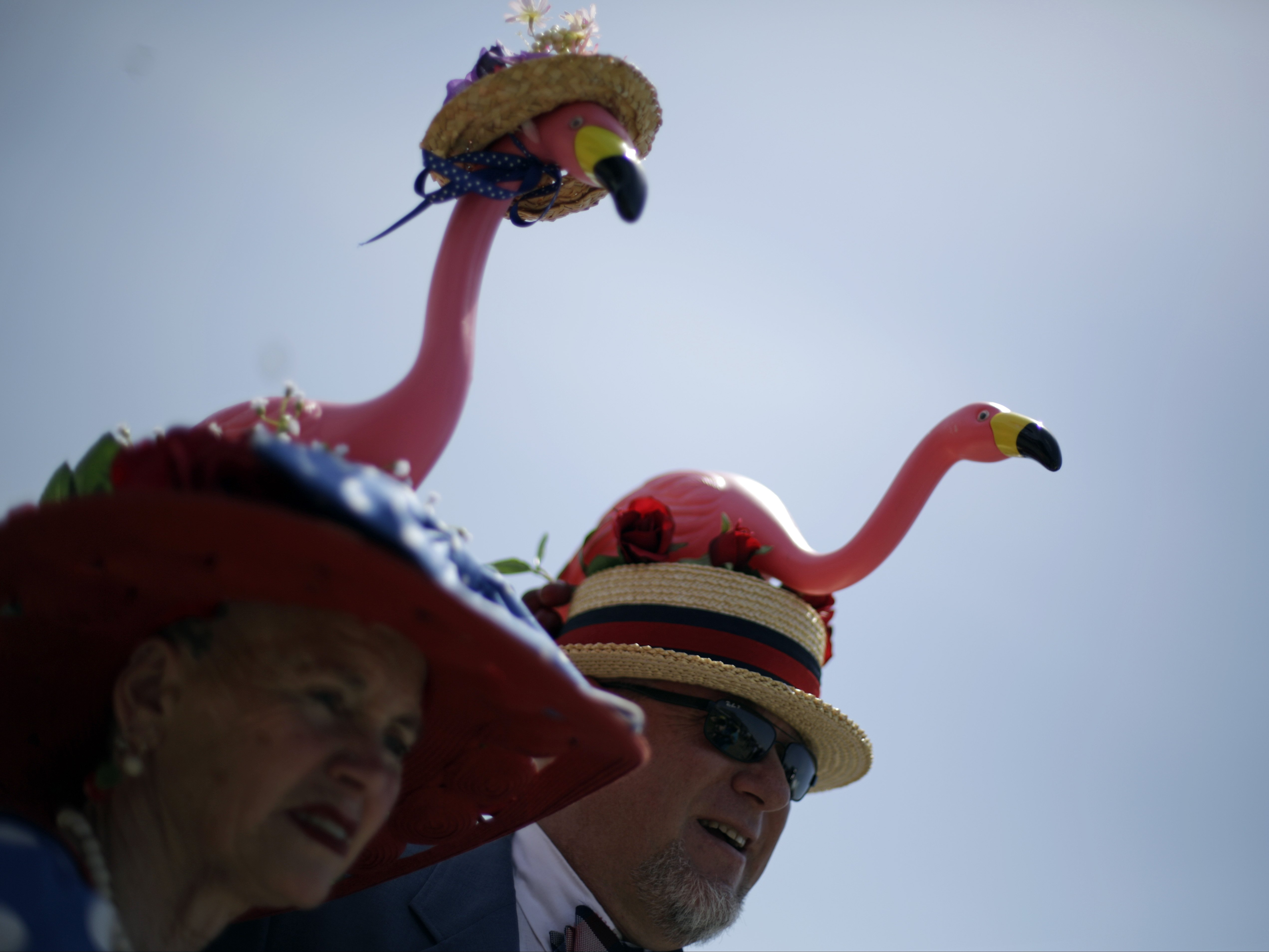 Scott and Jan Baty of Traverse City, Mich., in matching flamingo hats.