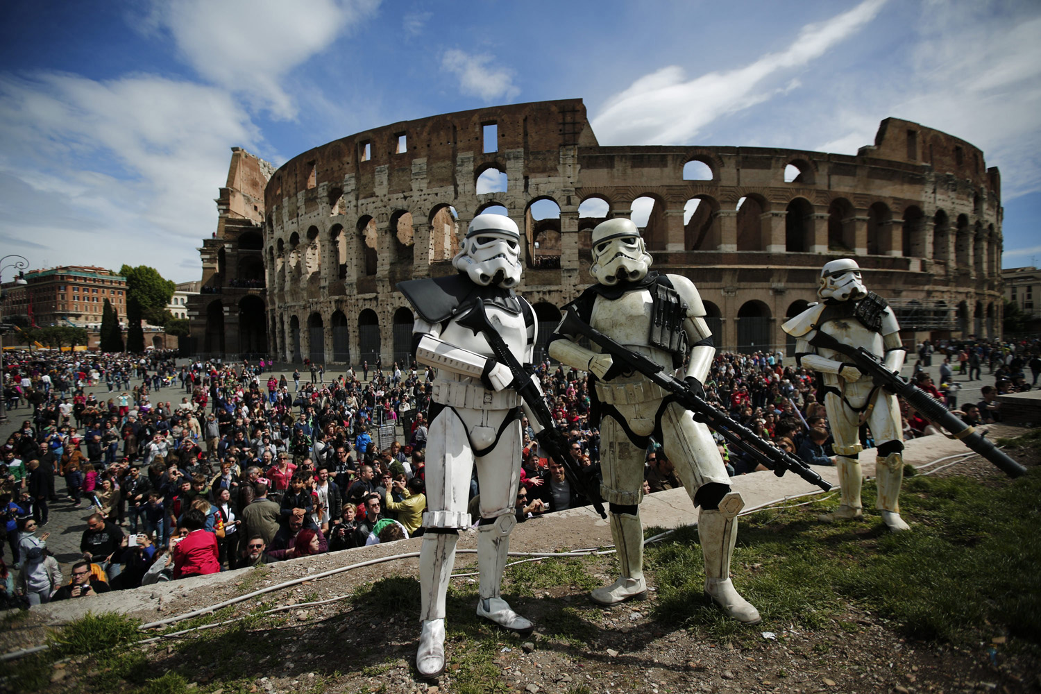 Members of the Star Wars fan club dressed as stormtroopers celebrate Star Wars Day in front of the Colosseum in central Rome on May 4, 2014.