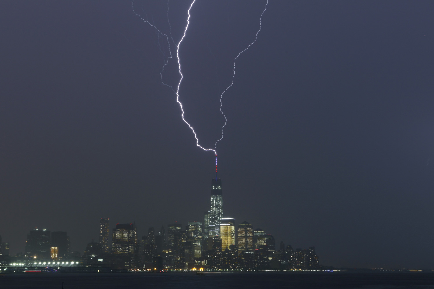 Two bolts of lightning hit the antenna on top of One World Trade Center in Lower Manhattan as an electrical storm moves over New York City on May 23, 2014.