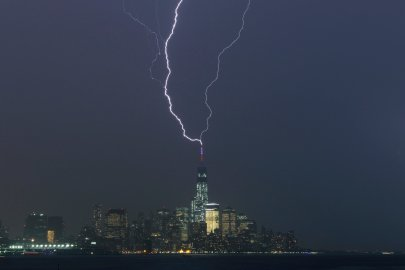 Two bolts of lightning hit the antenna on top of One World Trade Center in Lower Manhattan as an ele