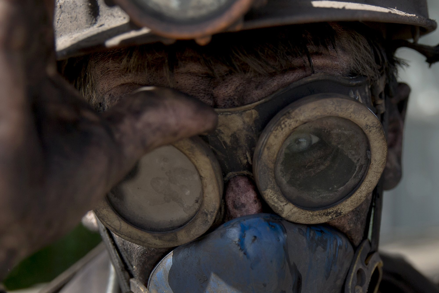 May 20, 2014. A Ukrainian coal miner wears his goggles after finishing his shift at a coal mine outside Donetsk, Ukraine.