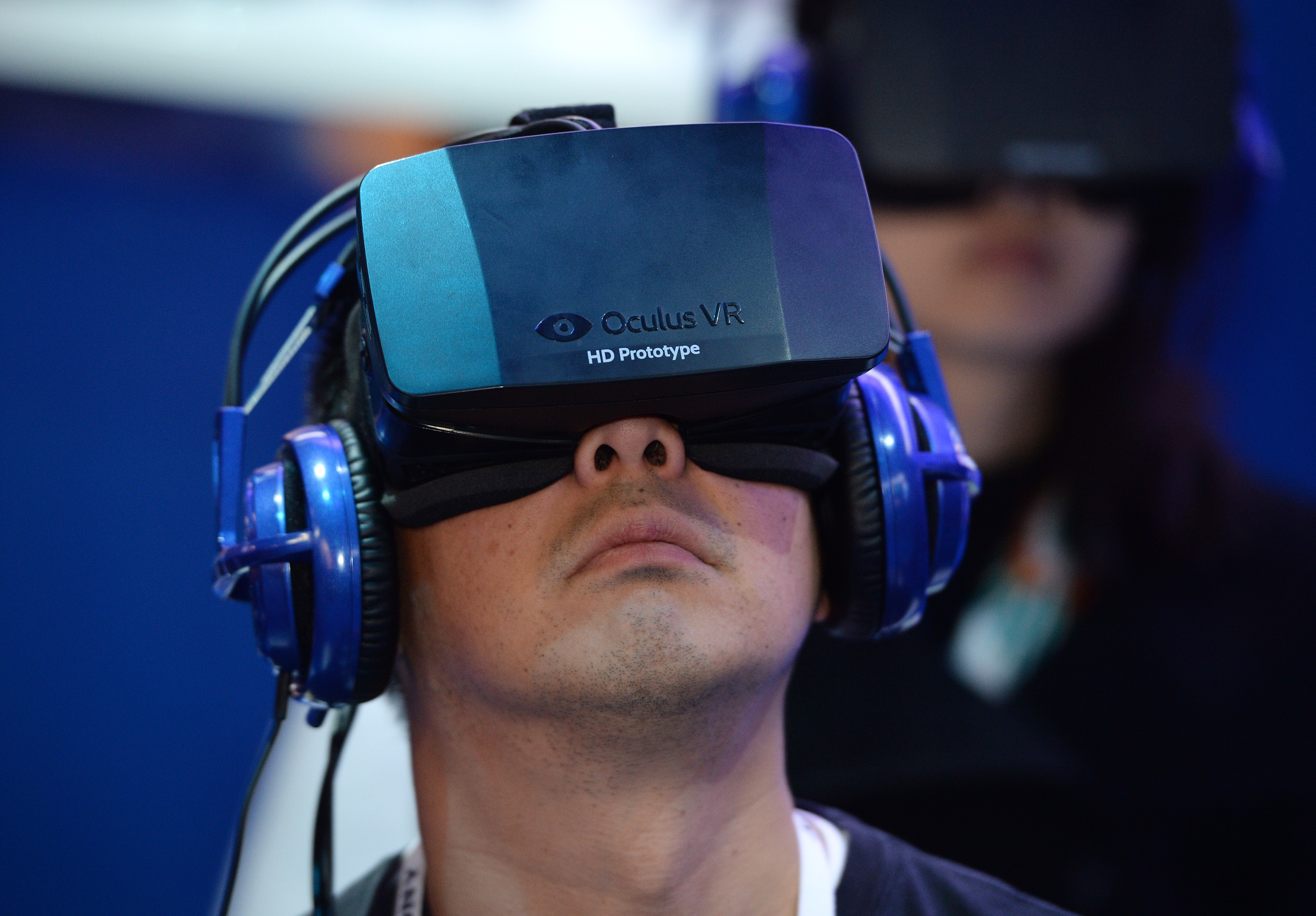 An attendee wears an Oculus Rift HD virtual reality head-mounted display at the 2014 International CES, January 9, 2014 in Las Vegas, Nevada.