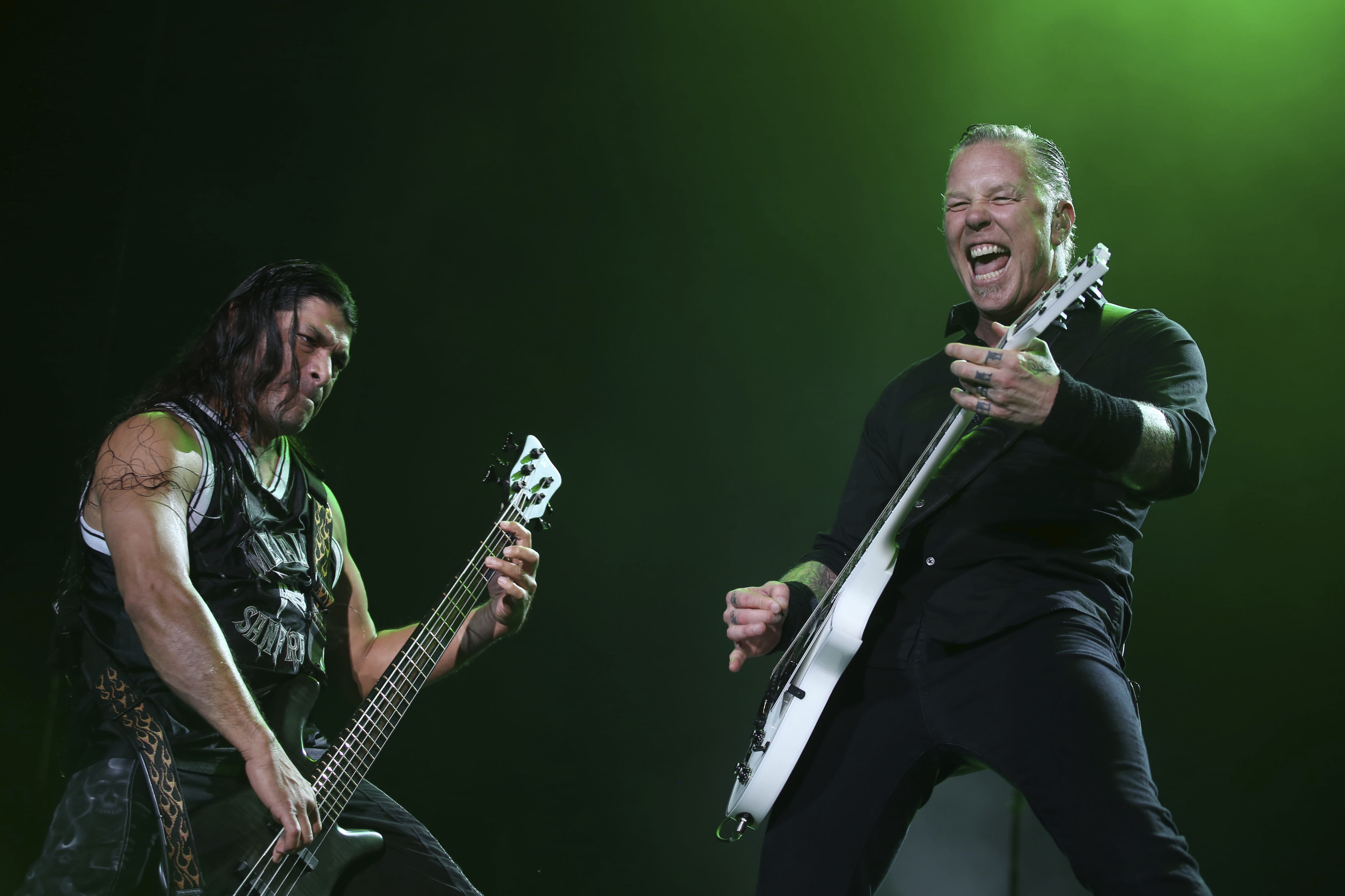 Vocalist and Guitarist James Hetfield (R) and bassist Robert Trujillo (L) perform during a show as part of their Metallica By Request Tour at Estadio Unico de la Plata on March 29, 2014 in La Plata, Argentina.