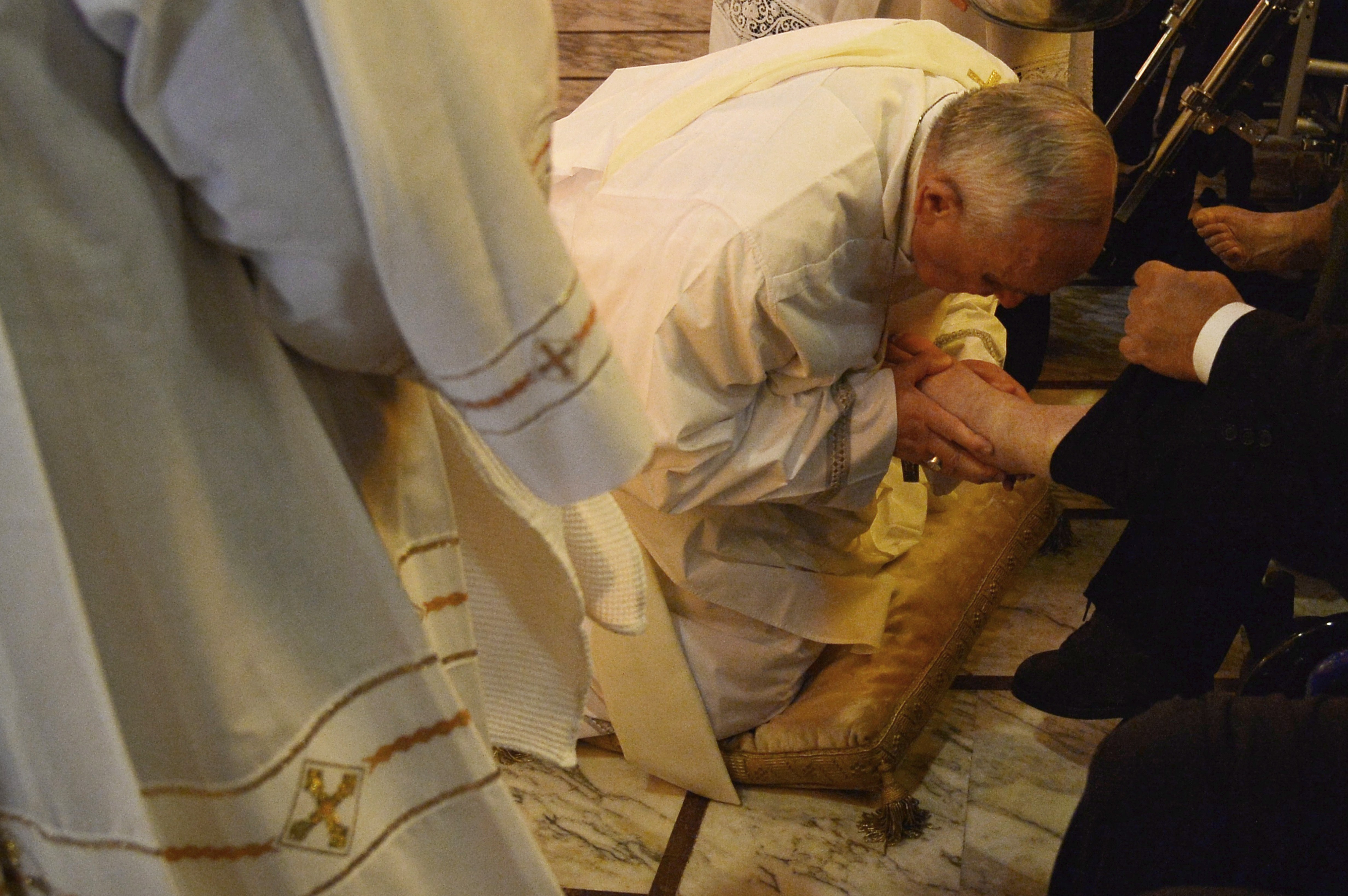 Pope Francis performs the traditional washing of the feet during a visit at a center for disabled people as part of Holy Thursday and Holy Week, April 17, 2014 in Rome.