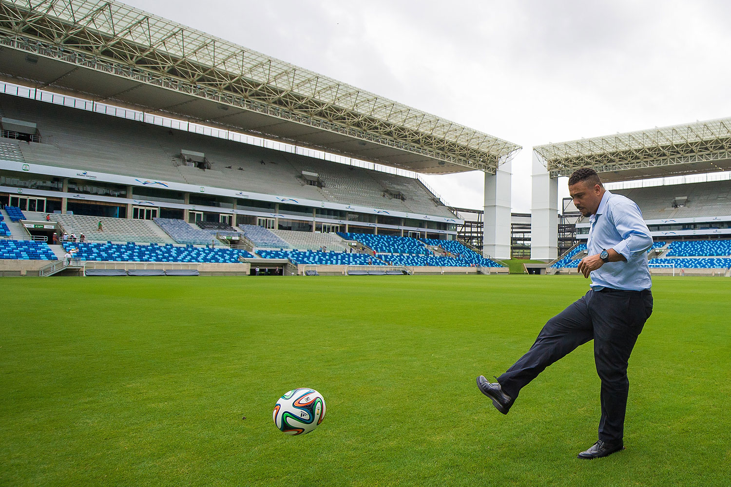 LOC Member Ronaldo Luis Nazario kicks the ball at Arena Pantanal during the 2014 FIFA World Cup Host City Tour on April 23, 2014 in Cuiaba, Brazil