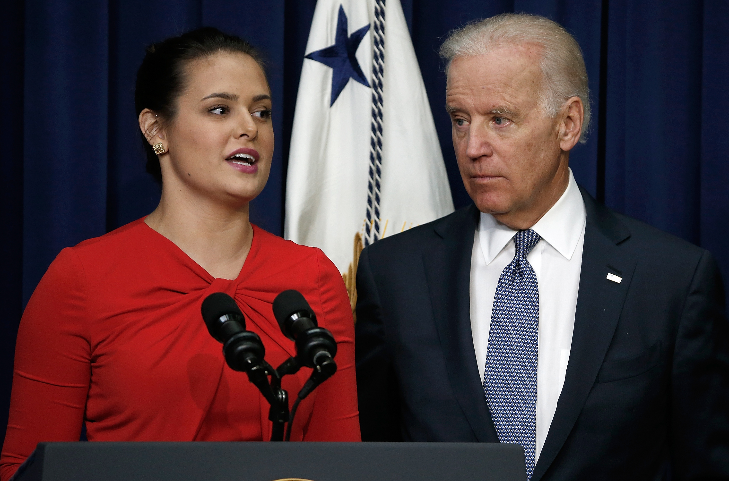 U.S Vice President Joe Biden listens as Madeleine Smith, a graduate of Harvard University who was raped while attending college, speaks during an event at the Eisenhower Executive Office Building, April 29, 2014 in Washington, DC. During the event, Biden announced the release of the first report of the White House Task Force to Protect Students from Sexual Assault.