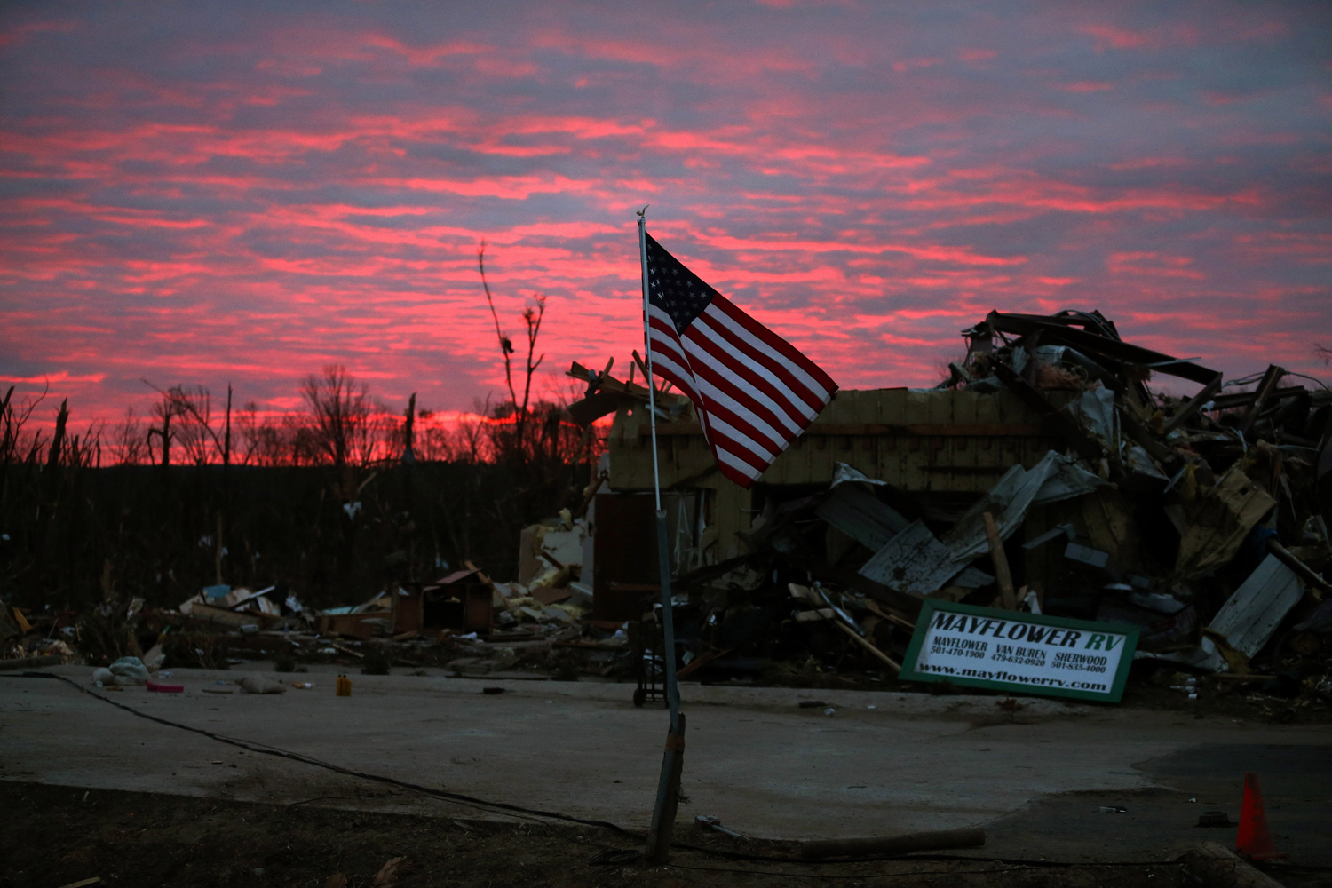 April 30, 2014. The sun rises behind a business that was destroyed by a tornado  in Mayflower, Arkansas.