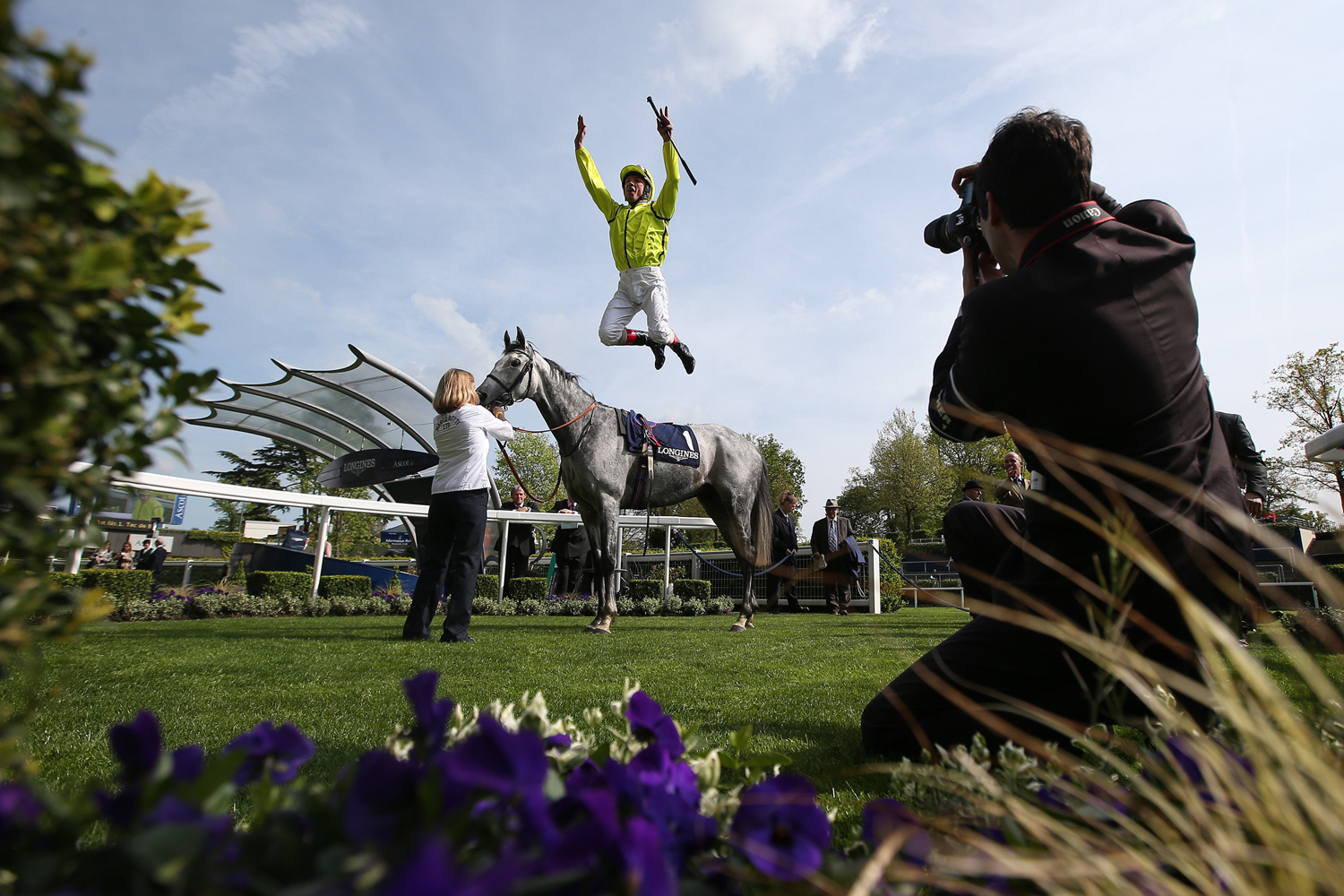 Frankie Dettori celebrates after ridding Tac De Boistron to victory in The Longines Sagari Stakes at Ascot racecourse on April 30, 2014 in Ascot, England.