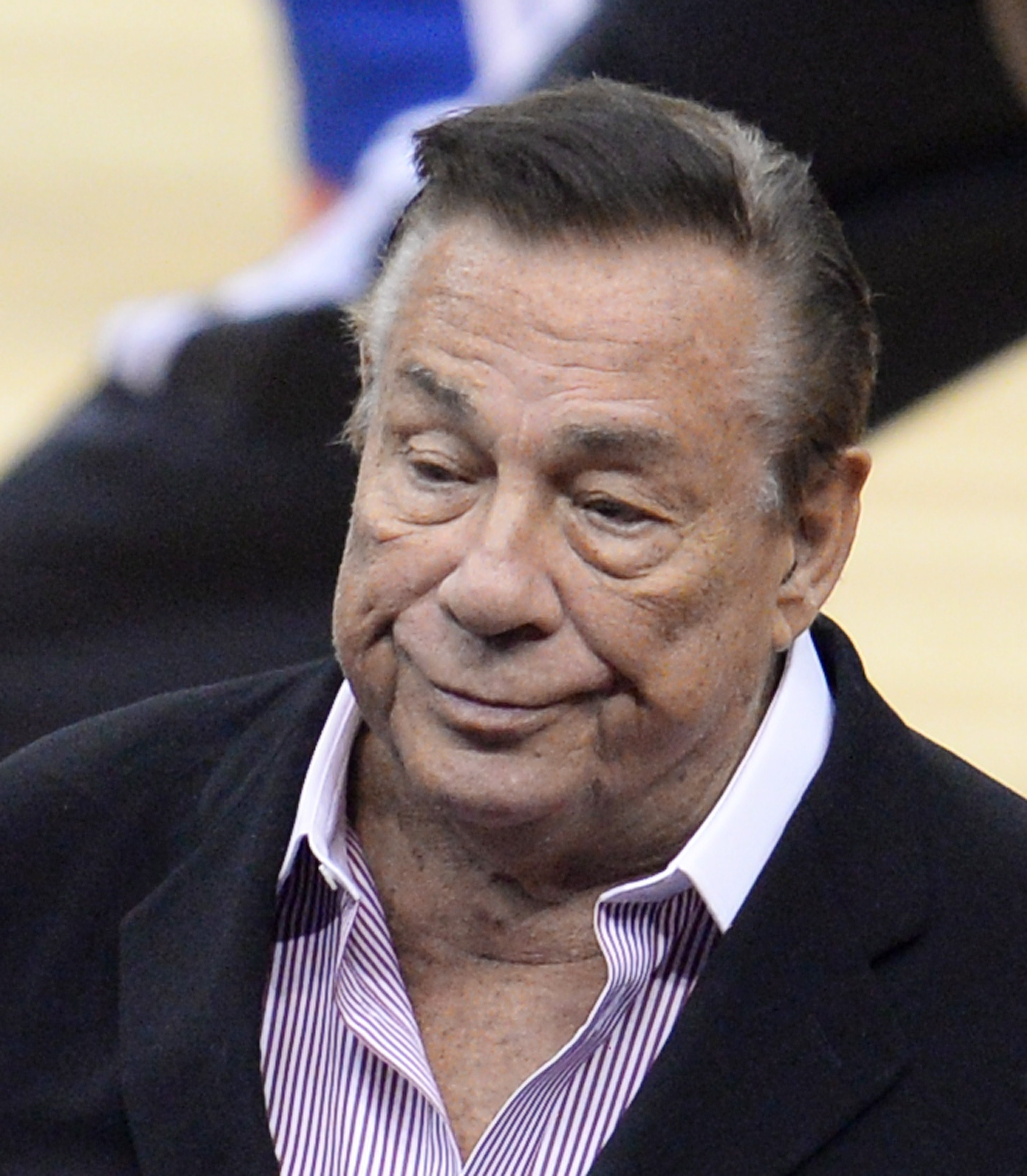 Los Angeles Clippers owner Donald Sterling attends the NBA playoff game between the Clippers and the Golden State Warriors on April 21, 2014 at Staples Center in Los Angeles, California. The NBA banned Sterling for life for  deeply offensive and harmful  racist comments that sparked a national firestorm. NBA Commissioner Adam Silver hit Sterling with every penalty at his disposal, fining him a maximum $2.5 million dollars and calling on other owners to force him to sell his team.   AFP PHOTO / ROBYN BECK        (Photo credit should read ROBYN BECK/AFP/Getty Images)