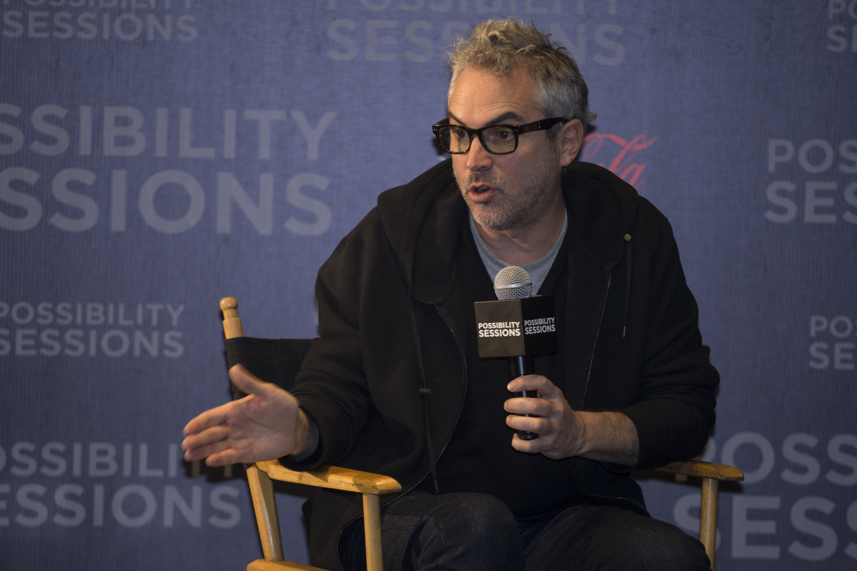 Mexican filmmaker Alfonso Cuaron attends a press conference to talk with university students on April 30, 2014.