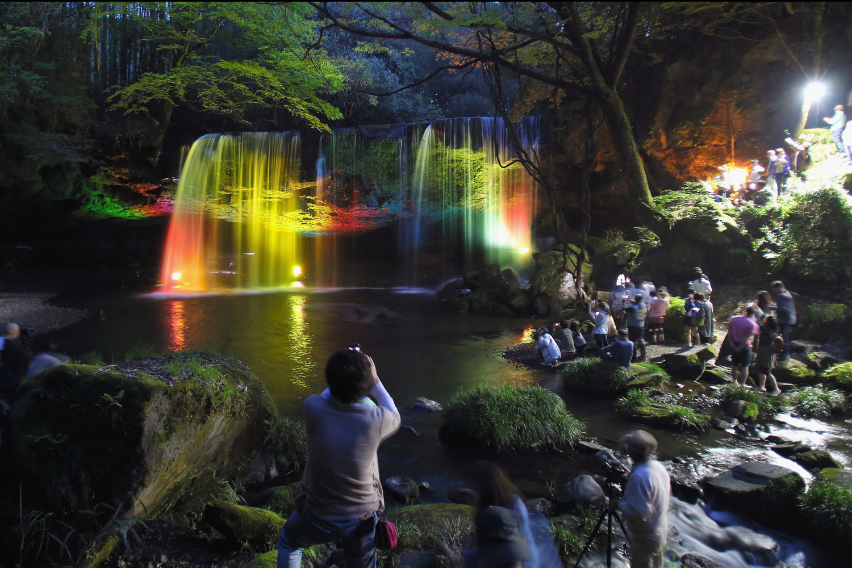 May 2, 2014. Tourists take photographs of the illuminated Nabegataki Fall in Oguni, Kumamoto, Japan. The annual illumination takes place May 3-6.