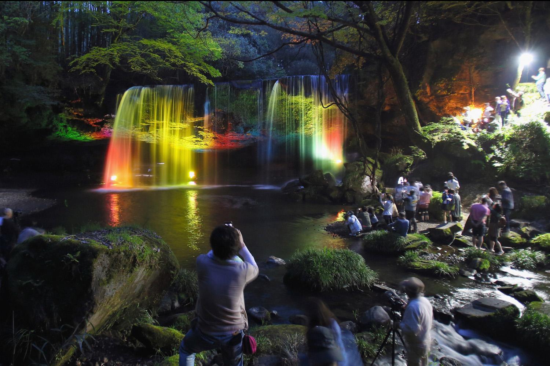 Tourists take photographs of the illuminated Nabegataki Fall on May 2, 2014 in Oguni, Kumamoto, Japan.