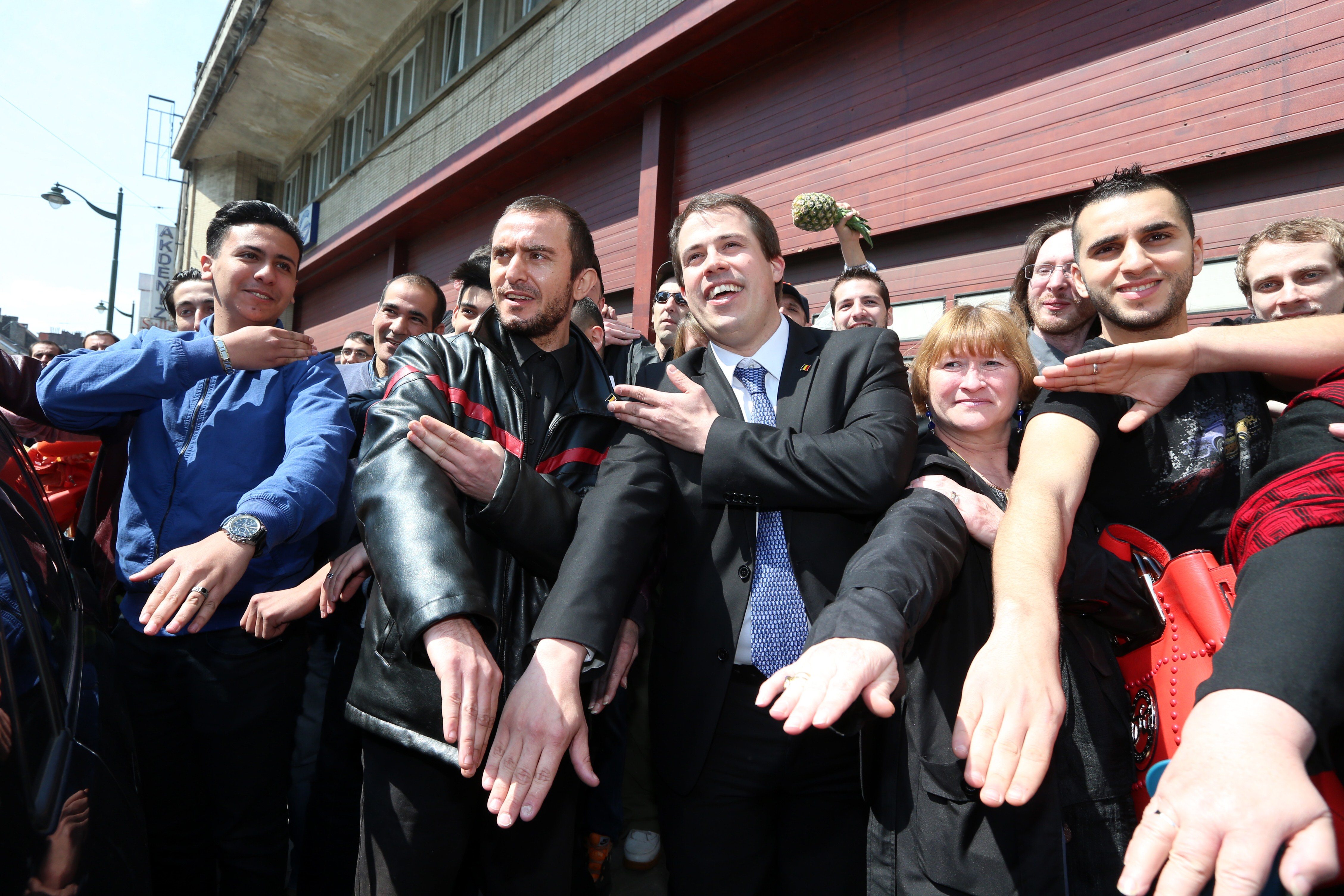 The leader of  Debout Les Belges!,  far-right lawmaker Laurent Louis (C) perform the 'quenelle' gesture ahead of the anti-Semitic congress,  First European Conference of Dissidence , organised by Chamber member Laurent Louis in Anderlecht, outside Brussels, on May 4, 2014.
