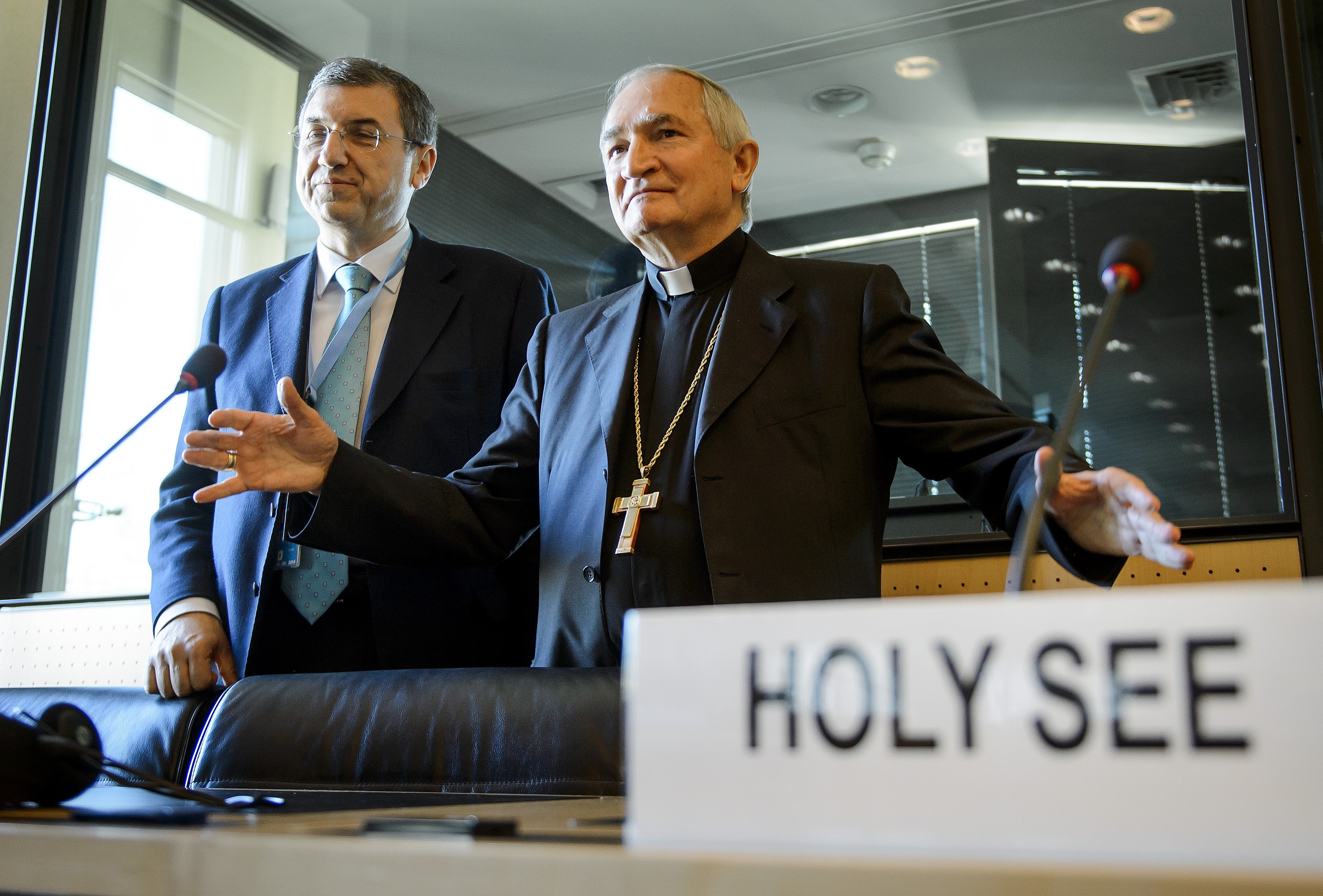 The Vatican's Ambassador to the United Nations Monsignor Silvano Tomasi (R) gestures next to Vatican Secretary of State Professor Vincenzo Buonomo (L) during a hearing before the United Nations (UN) Committee Against Torture on May 5, 2014, in Geneva.