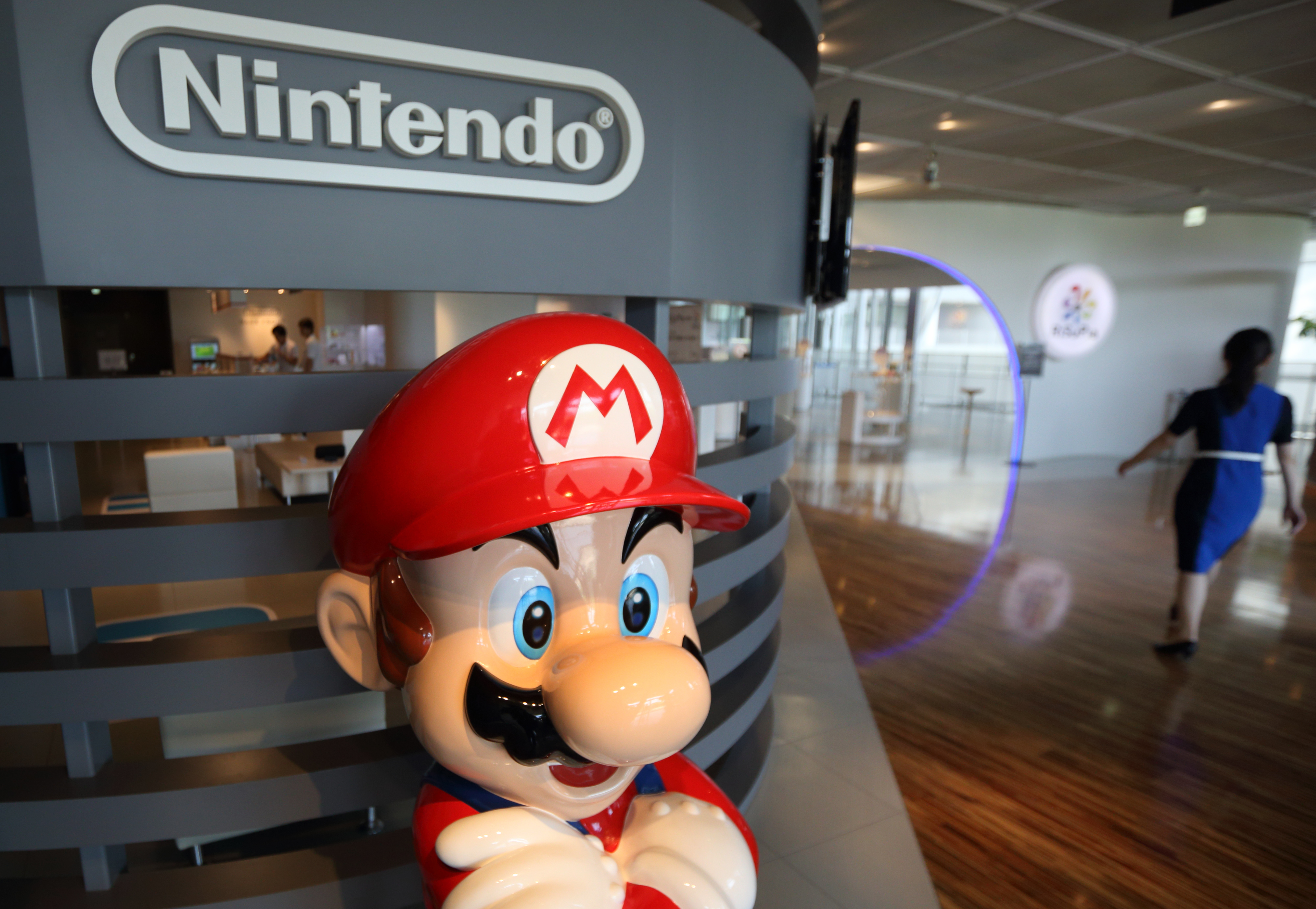 A statue of Nintendo Co.'s video-game character Mario stands at the company's showroom in Tokyo on Wednesday, May 7, 2014.