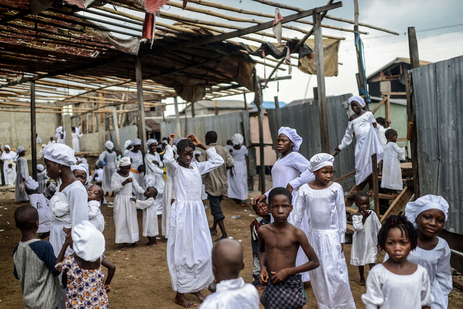 May 4, 2014. Christians wait for a religious ceremony at the Church of God in the floating Slum neighborhood of Makoko in Lagos, Nigeria.