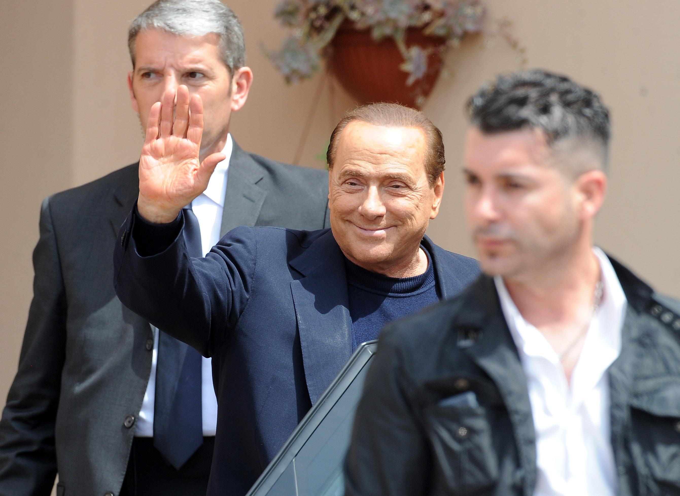 Berlusconi leaves the Fondazione Sacra Famiglia on May 9, 2014 in Milan, Italy.