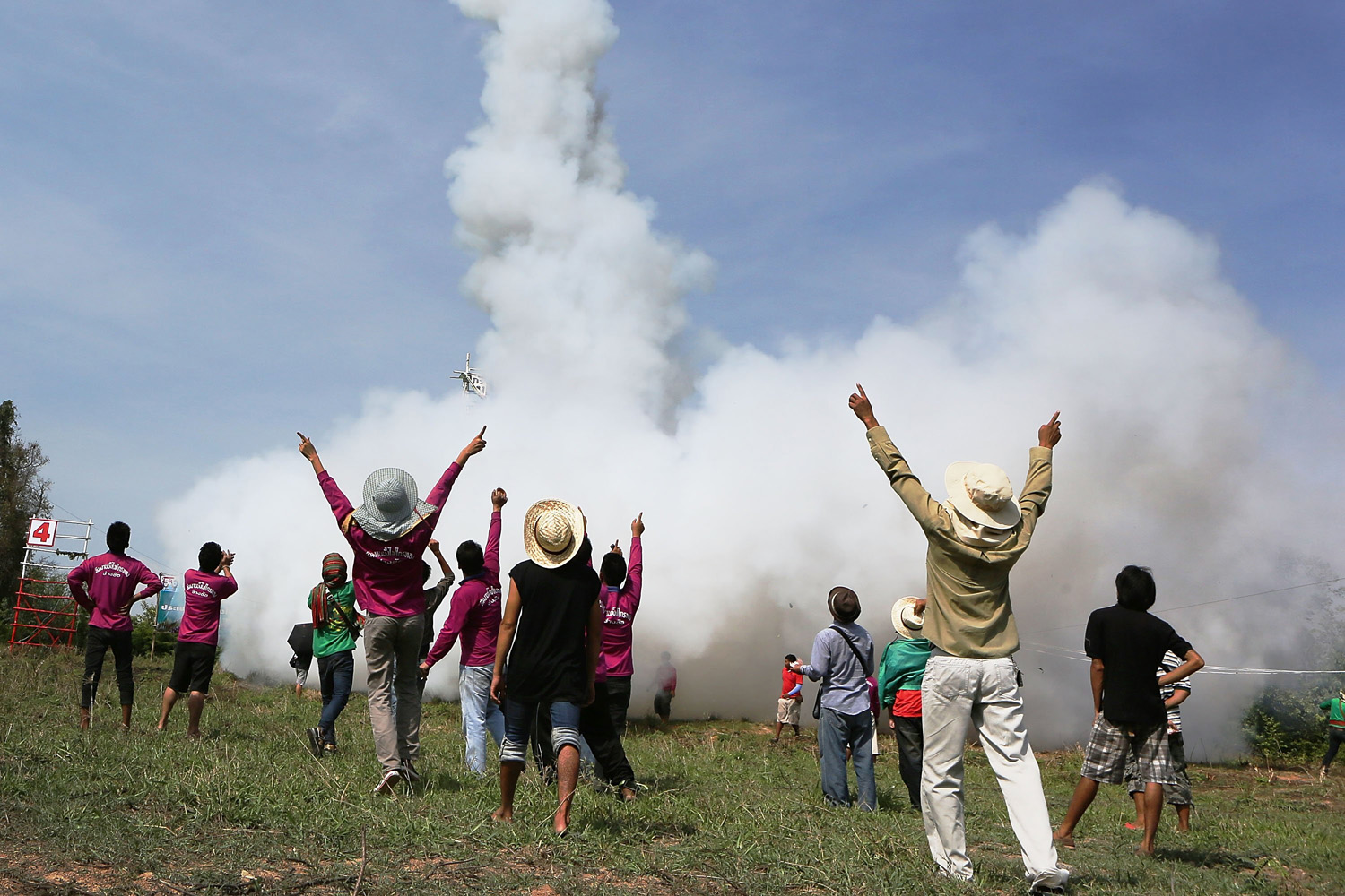 Thai men react to a particularly well-launched rocket during the Bun Bang Fai festival on May 11, 2014 in Yasothon, Thailand.