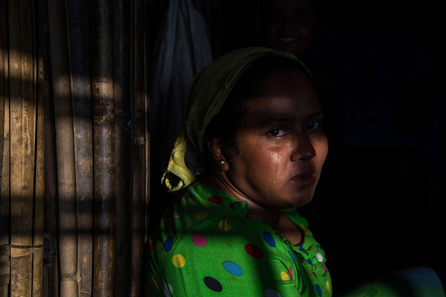 May 9, 2014.  Noorba Goung cries inside a tent after her first baby died at Dar Paing refugees camp in Sittwe, Burma.