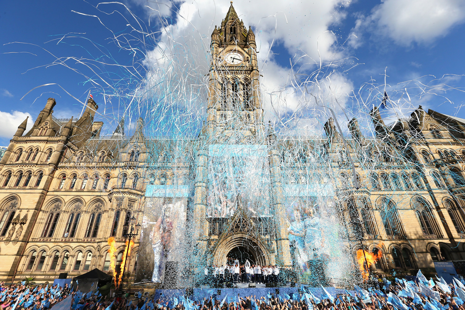 Vincent Kompany of Manchester City lifts the Barclays Premier League trophy aloft outside Manchester Town Hall at the start of the Manchester City victory parade on May 12, 2014 in Manchester, England.