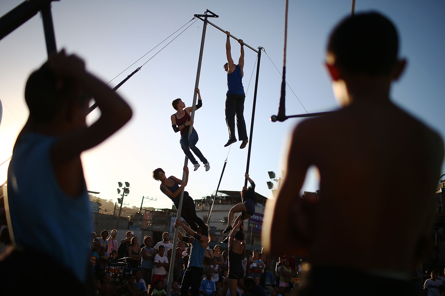 May 12, 2014. Artists from the Cia Base circus group perform in the show Futebol Voador (Flying Soccer) during the International Circus Festival in the Vila Cruzeiro slum, or favela, in Rio de Janeiro, Brazil.