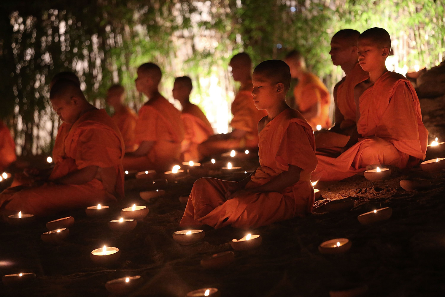 May 13, 2014. Thai monks at Wat Pan Tao take part in a candle lighting ceremony celebrating Visak Day onin Chiang Mai, Thailand.